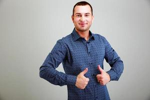 Funny man with thumbs up photo