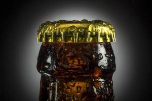 beer bottle with water drops photo