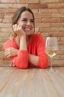 woman and a glass of white wine photo