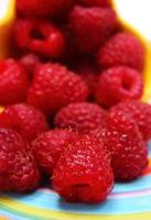 Fresh raspberries on colorful plate