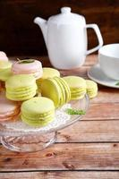 Macaroon on a stand with teapot and cup
