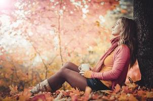 Young woman in autumn park, photo