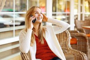Pretty woman talking on the smartphone outdoors