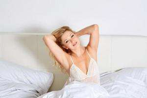 Smiling woman in her bedroom photo