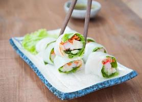 Delicious vietnamese spring roll with vegetable and chili