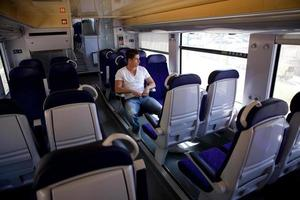 Young man posing in the train. photo
