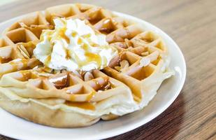 waffles under the caramel topping with cream on top