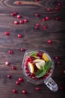 Homemade lemonade with cranberry and mint photo