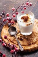 vaso de delicioso yogur muesli foto