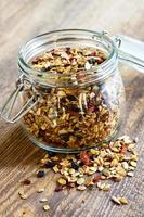 Homemade granola in open glass jar