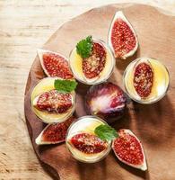 Creamy white yogurt with honey, figs and mint