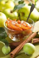 Apple jam with cinnamon and fresh fruits photo
