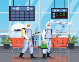 Two biosafety workers disinfect airport