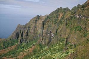 Green mountain near sea  photo