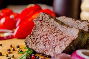 Tender succulent slice of roast beef photo