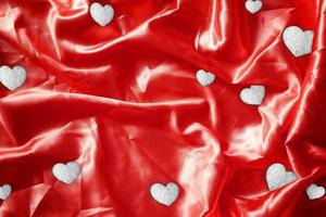 Heart shiny foil Bronze on Red fabric silk for background photo