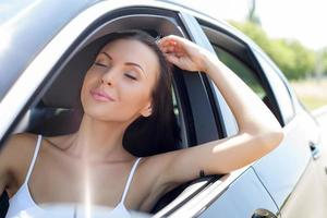 Beautiful young woman is relaxing in her transport