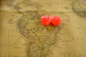 Sweet heart candy present love in old Brazil map photo