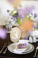 table appointments and decor with flowers, number