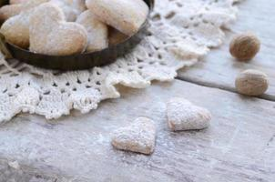 Homemade heart shaped cookies on wooden background in vintage style