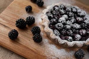 blackberry pie on a wooden table photo