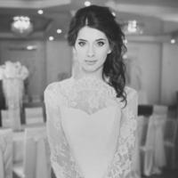 Beautiful young caucasian bride in fashionable wedding dress.