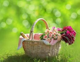 Romance, love and valentine's day concept - basket with flowers