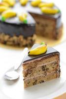 Chocolate banana cake isolated on white background photo