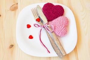 table setting for valentine's day with knitted toys