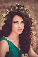Pretty brunette girl with wreath