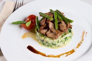 Tasty Main Dish on White Plate photo