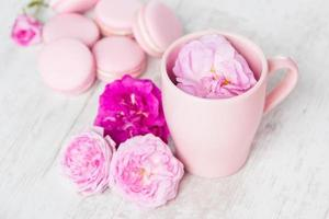 Tea cup with rose and macaroons photo