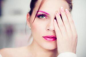 The woman with a bright pink make-up.
