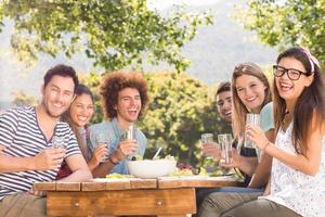 Happy friends in the park having lunch photo