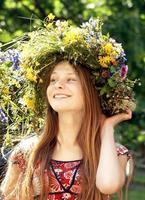 Beautiful girl with wreath