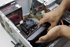 Technician replacing a graphics card