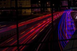 Time lapse of car lights on road