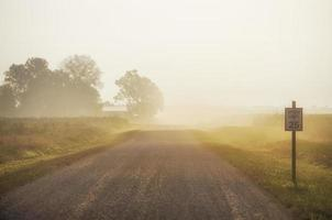 Dusty gravel road in the early morning photo