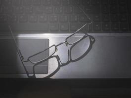 Eye glasses on laptop