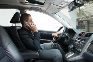 Man talking on phone in car