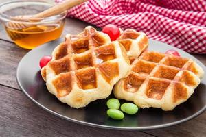 Waffles with honey on plate