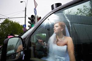 Elegant bride into big car