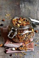 Granola in a glass jar. photo