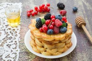 Home made waffles with fresh berries and honey