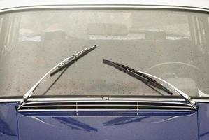 window with wipers of vintage car photo