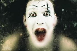 Scary face screaming mime photo