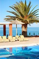 Swimming pool by beach at modern luxury hotel, Thassos