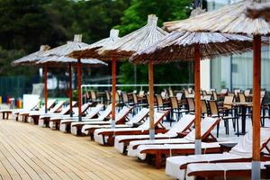 Beach umbrellas at the hotel lounge chairs