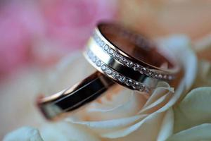 Pair of wedding rings with flowers