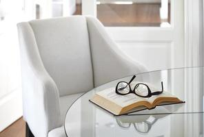 Living room armchair with book and eyeglasses